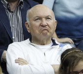 Moscow mayor Luzhkov reacts as he watches the play of compatriot Petrova against Spain's Navarro during their Fed Cup tennis match in Moscow